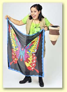 Photo of Bernadette holding a big silk with a butterfly printed on it.