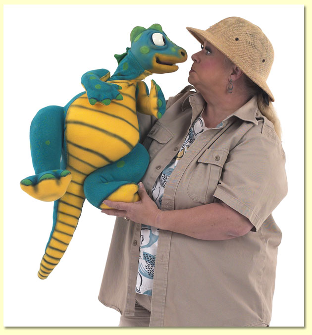 Large photo of ventriloquist and puppeteer Margaret Clauder, dressed as Paleo-Maggie, with a dinosaur puppet.