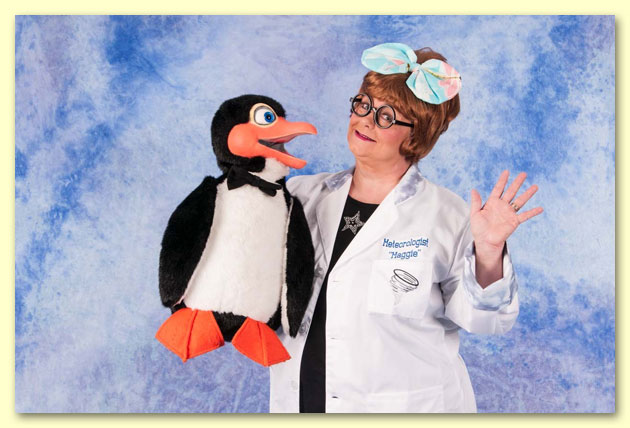 Large photograph of Meteorologist Maggie with Chilly the Penguin