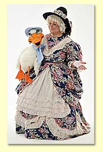 Picture of Mother Goose introducing Goosey to the children in the audience.
