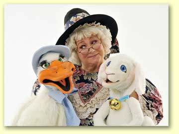 Photo of Mother Goose with her puppets Goosey and Lamby.