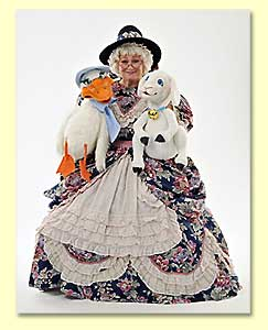 Picture of Mother Goose - a Texas performer - posing with puppets Lambie and Goosie.