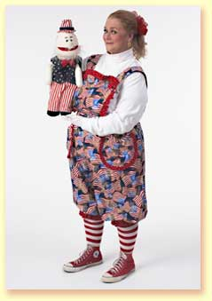 Photo of Margaret Clauder with Uncle Sam the hand puppet.