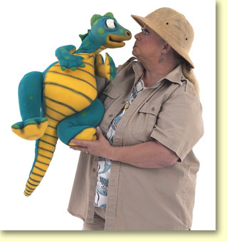 Photo of Margaret Clauder dressed as Paleo Maggie, holding her read-a-saurus puppet.
