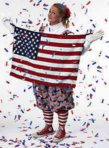 Picture of Margaret Clauder as Patriotic Patty, holding a U.S. flag.